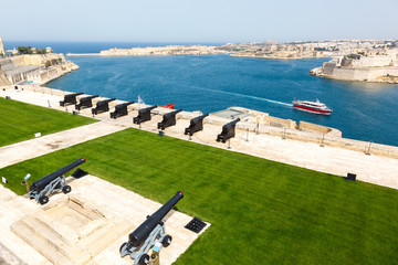 battery and Grand Harbor of Valletta