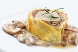 Slice of Wellington pork tenderloin with mushrooms