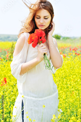 beautiful girl in rapeseed field