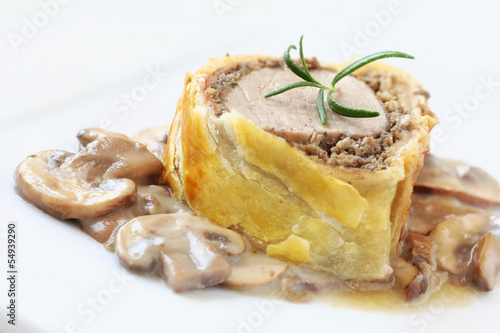 Slice of Wellington pork tenderloin with mushrooms