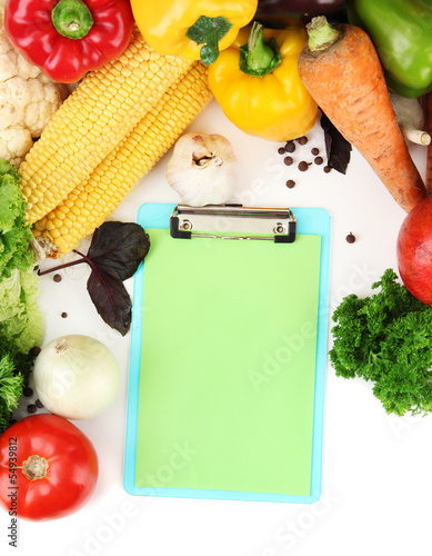 Fresh vegetables and spices and paper for notes, isolated