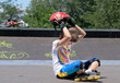 Young teenage roller skater removing her helmet