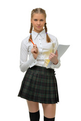 Beautiful blonde school girl with notebook and pen in hands