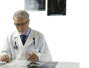 Doctor in hospital sitting at desk
