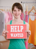 Job offer: Woman with Help Wanted sign