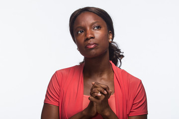 Young African-American woman posing with hands clasped