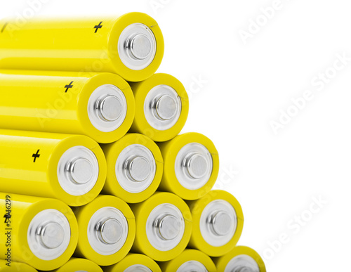 Stack of yellow batteries with space for your text