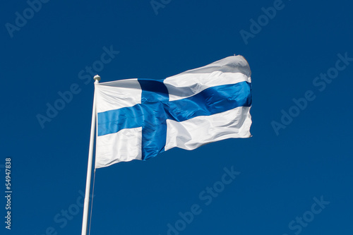 Deurstickers Scandinavië Flag of Finland before blue sky.