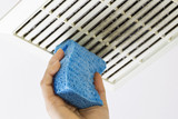 Cleaning Bathroom Fan Vent Cover with Sponge