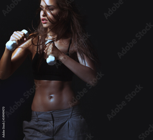 Sexy woman working out with dumbell
