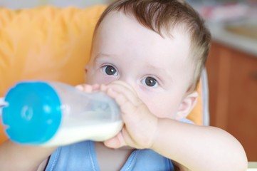 Baby eats from small bottle