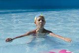 young girl swims play in pool