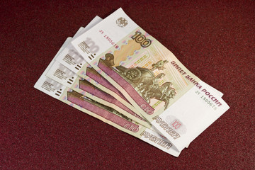 money in rubles on a red background