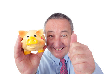 Man with piggy bank holding thumbs up