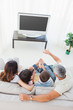 Family with popcorn watching their television on sofa