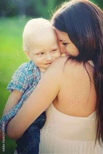 Young Mother and her little son, filled with tenderness, toned