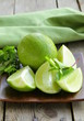 Fresh limes with green mint - chopped and whole