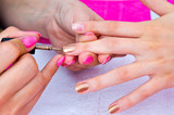 nail polishing in manicure salon