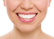 Dental care woman. Female with white teeth smiling, isolated