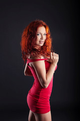 Exciting red-haired woman looking at camera