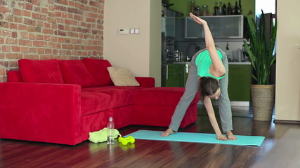 Young woman exercising in home