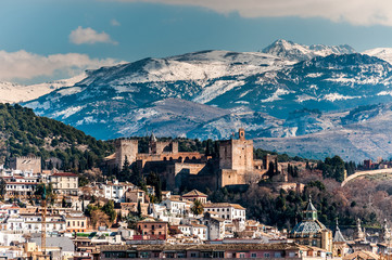 Winter view of famous Alhambra in front of Sierra Nevada.