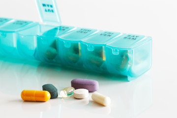 A weekly container of tablets, vitamins etc