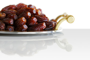 Dried Arabic dates presented on an ornate tra