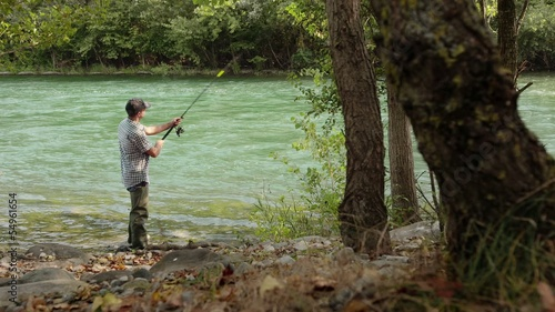 6of8 Man with rod fishing trout on river in Italy