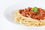 Spaghetti bolognese decorated with coriander leaf