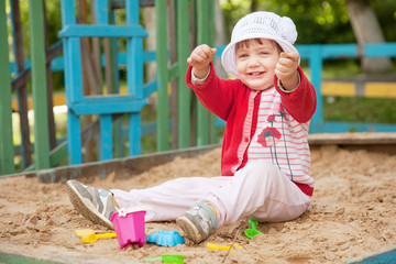 two-year child  in sandbox