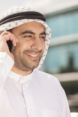 Arab businessman on the phone. Cheerful Arab businessman talking