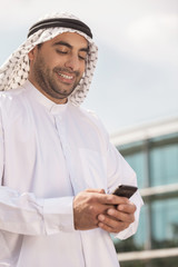 Arab businessman with mobile phone. Confident Arab businessman h