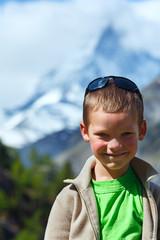 Boy and summer Matterhorh mountain, Alps