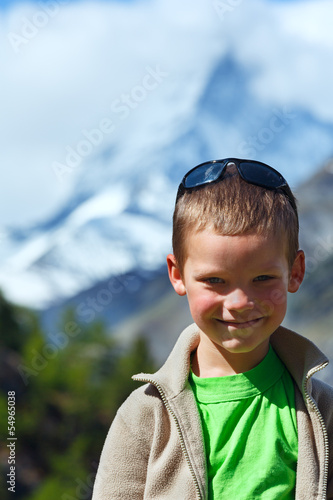 Boy and summer Matterhorh mountain, Alps