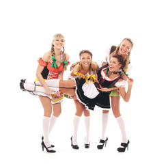 Four young women in Bavarian clothes playing together