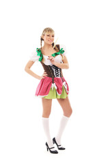 A young and happy blond woman posing in bavarian clothes
