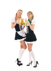 A couple ot young women in Bavarian clothes holding beer