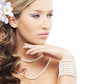 Portrait of a young blond woman in beautiful pearl jewelry