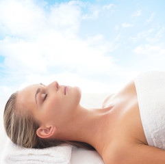 Portrait of a young woman relaxing on a spa massage procedure