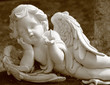 little angel with butterfly, statue in sepia