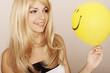 Girl holding smiley face balloon