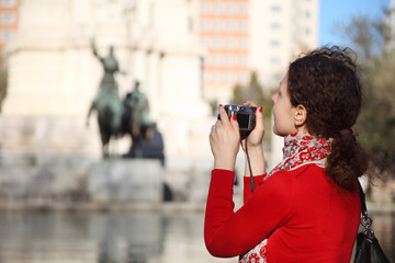 Woman photographs monument to Don Quixote