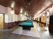 Billiard tables with green cloth inside stylish club