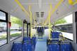Leinwanddruck Bild - Blue seats inside saloon of empty city bus