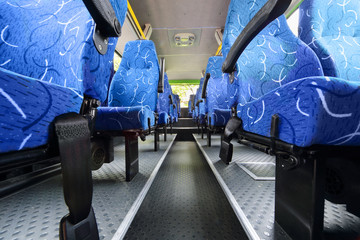 Seats in saloon of empty city bus