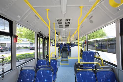 Leinwanddruck Bild Blue seats inside saloon of empty city bus
