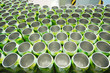 Many open aluminum cans for drinks move on conveyor