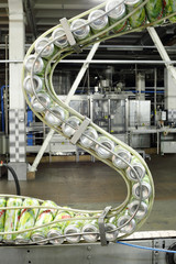Cans of mojitos on S-shaped conveyor