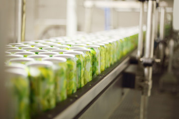 Empty aluminum cans for drinks move on conveyor at large factory